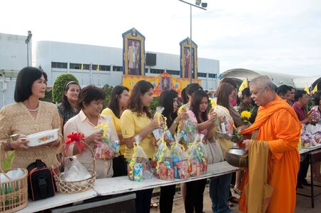 adulyadej: YALA, THAILAND - DECEMBER 5: Unidentified Yala people put food offerings for monks in blessing ceremony for the H.M.K. Bhumibol Adulyadej Birthday ceremony on Dec 5, 2011 at Yala Youth Center, Thailand Editorial