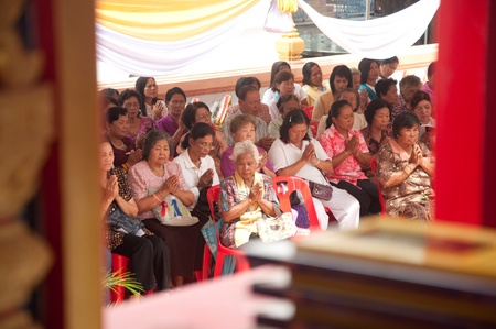 adulyadej: YALA, THAILAND - OCTOBER 14: Unidentified Yala senior female chants for ceremony in the H.M.K. Bhumibol Adulyadej giving Monks Robes ceremony on Oct 18, 2011 at Yala Putt Temple, Thailand Editorial