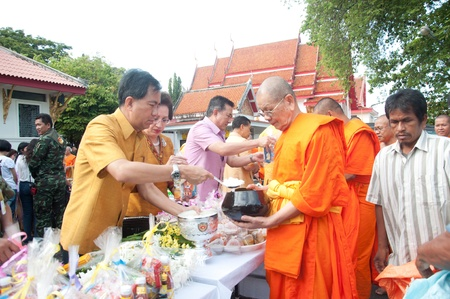 YALA, THAILAND - OCTOBER 22:Mr.Krissada Boonrach gives food offerings to monk in blessing ceremony for H.M.K. Bhumibol Adulyadej Birthday ceremony on Oct 22, 2011 at Yala Puttaphum Temple, Thailand Stock Photo - 11653474