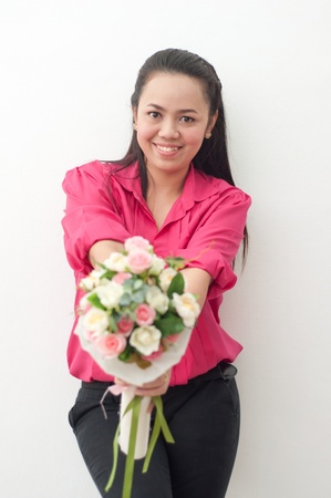 asian thai attractive woman in red shirt isolate on white holding flower photo