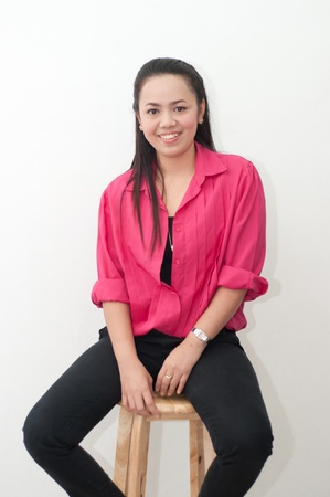 asian thai attractive woman in red shirt isolate on white sitting on chair photo