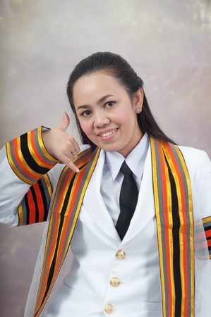 asian thai attractive Graduate female student - phone calling hand sign concept photo