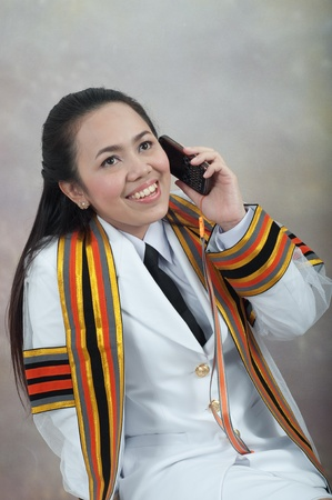 asian thai attractive Graduate female student - mobile phone calling concept photo