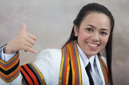 asian thai attractive Graduate female student - phone calling hand sign concept Stock Photo - 11669885