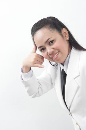 asian thai young business woman in white dress - phone calling hand sign concept Stock Photo - 11668035