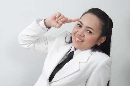 asian thai young business woman in white dress thinking concept Stock Photo - 11668043