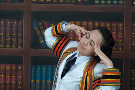 asian thai attractive Graduate female student in library headache concept photo