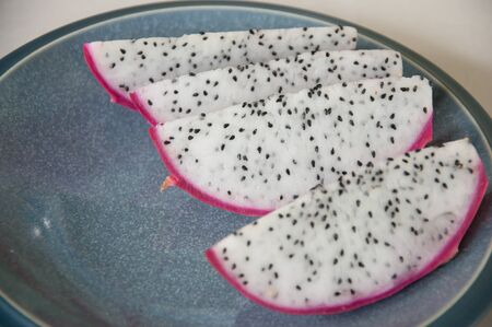 Slice Pitahaya, Dragon Fruit in dish -  Hylocercus undatus (Haw) Brit. & Rose. Stock Photo - 12338737