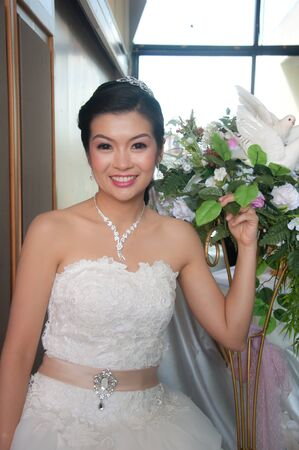 attractive young asian Bride photo