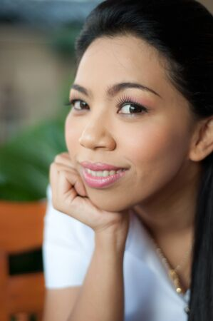 smiling asian attractive college student woman in white unifom photo