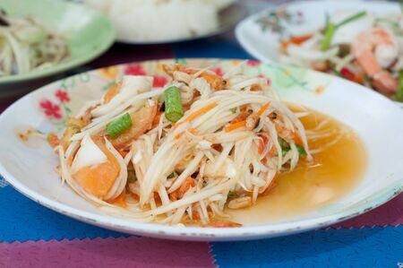 somtum: thai papaya salad with salt egg - somtum