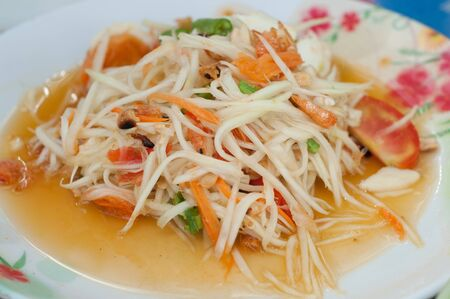 thai papaya salad with salt egg - somtum photo