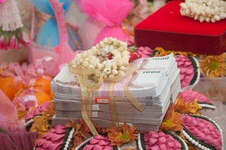 bride price money in thai wedding ceremony photo