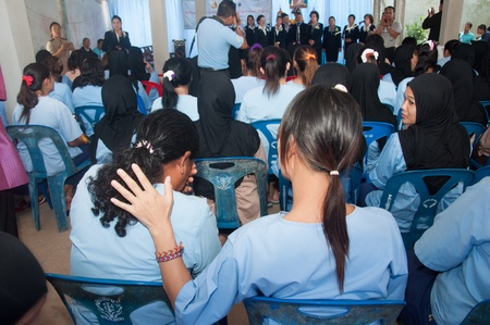 YALA, THAILAND - AUGUST 10: Unidentified Female Prisoner crys while listen to a song in Queen Sirikit food give to female prisoners on Aug 10, 2012 at Yala Department of Corrections, Thailand