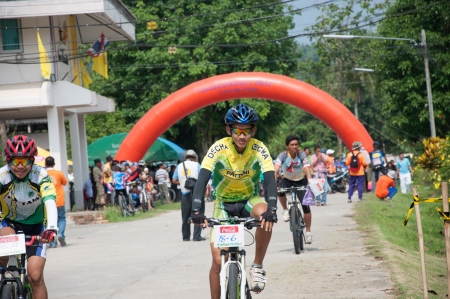 YALA, THAILAND - APRIL 1: Unidentified man ride mountain bike for race in Krongpinang Mountain Bike Racing on Apr 1, 2012 at  Yala Krongpinang district office, Thailand Stock Photo - 15837428