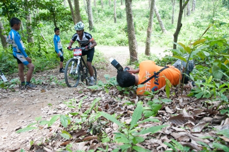YALA, THAILAND - APRIL 1: Mr.Attapol Nowat takes picture for race in Krongpinang Mountain Bike Racing on Apr 1, 2012 at  Yala Krongpinang district office, Thailand Stock Photo - 15837546