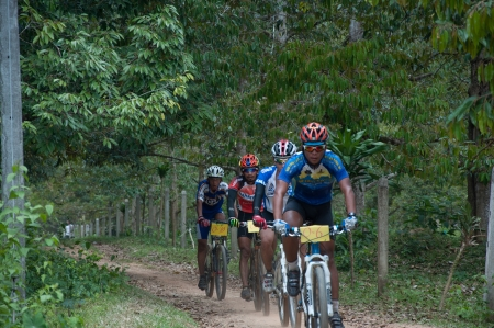 YALA, THAILAND - APRIL 1: Unidentified man rides mountain bike for race in Krongpinang Mountain Bike Racing on Apr 1, 2012 at  Yala Krongpinang district office, Thailand