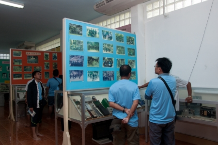 YALA, THAILAND-SEPTEMBER 22: Unidentified Visitors see old pictures Inside chinese museum on Sep 22, 2012 at Yala No.9 Chulaporn Development Village, Thailand Stock Photo - 16284887