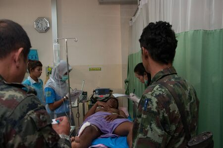 YALA, THAILAND - FEBUARY 23: Unidentified soldier injury from time bomb explode on bed in emergency room on Feb 23, 2012 at Yaha Hospital Yala, Thailand