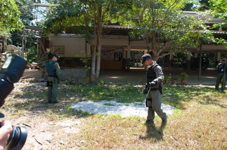 explotion: YALA, THAILAND - FEBUARY 23: Explosive Ordnance Disposal Police search for time bomb after time bomb explode on Feb 23, 2012 at Yaha Samukkee School Yala, Thailand Editorial