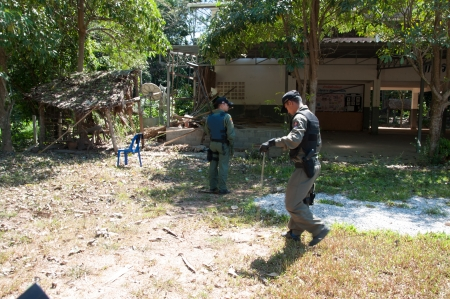 YALA, THAILAND - FEBUARY 23: Explosive Ordnance Disposal Police search for time bomb after time bomb explode on Feb 23, 2012 at Yaha Samukkee School Yala, Thailand