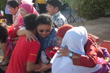 retire: YALA, THAILAND - SEPTEMBER 21:Kanarasadornbumroong students give hug to retire teachers for retire ceremony on Sep 21, 2012 at Yala Kanarasadornbumroong school, Thailand Editorial
