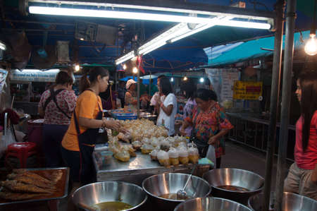 KRABI, THAILAND - OCTOBER 26: Unidentified female buy thai local food and curry in krabi market on 26 Oct, 2012 at Krabi Market, Thailand