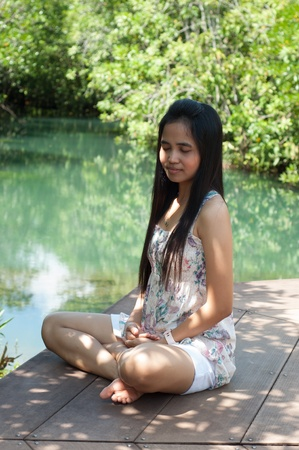 meditation asian woman in beautiful nature Stock Photo