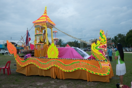 harmonize: YALA, THAILAND - OCTOBER 31: Colorful Buddhism Ship show for buddhism people to give donation for temple in Buddhist day Oug Pansa on 31 Oct, 2012 at Yala Youth Center, Thailand