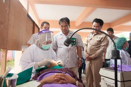 YALA-YAHA, THAILAND - NOVEMBER 8: Unidentified dentist patient in bed fixing teeth in Province Service Project on 8 Nov, 2012 at Yaha Arsin Sueksa School, Thailand Stock Photo - 17228010