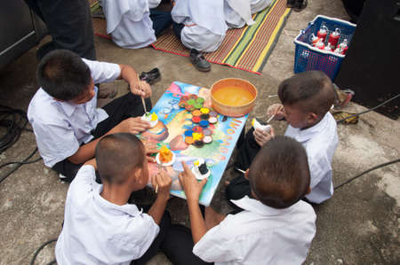 innocense: YALA-YAHA, THAILAND - NOVEMBER 8: Unidentified male kids paint color to toy in Province Service Project on 8 Nov, 2012 at Yaha Arsin Sueksa School, Thailand