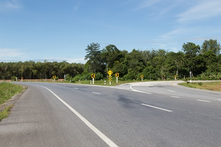 split road: traffic sign of split road in yala, thailand Stock Photo