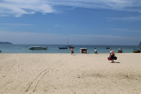 mook: Foreign travellers carry their bags to speed boat at Mook Island Andaman Sea