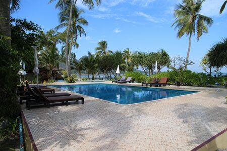 Swimming Pool and sea view at Mook Island in Trang, Thailand