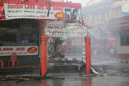 mart: TRANG, THAILAND - AUGUST 12: Fire fighting at Lee Mart, the old shopping center name Diamond plaza was the first shopping center of Trang on fire this morning on Aug 12, 2016 at Lee Mart in front of Trang Railway Station, Thailand