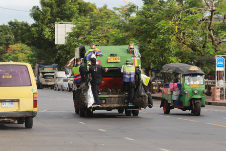leavings: Bangkok, Thailand - September 3, 2016: Bangkok Waste Car with workers is on duty. Bangkok is one of the place that have many waste to clean out. Editorial