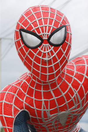 marvel: Petchaburi, Thailand - September 1, 2016: Spiderman Statue face close up. Spiderman is famous marvel comic hero. This Spiderman statue is locate at Mae Kim Lung dessert shop in Petchaburi, Thailand.