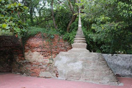 nakhon pathom: Old Stupa with brick wall at Wat Phra Pathommachedi Ratcha Wora Maha Wihan in Nakhon Pathom, Thailand Stock Photo