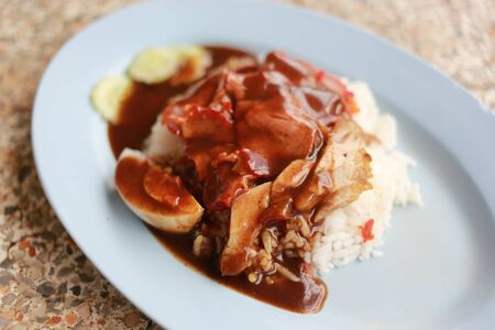 barbecued: Barbecued red pork in sauce with rice on dish