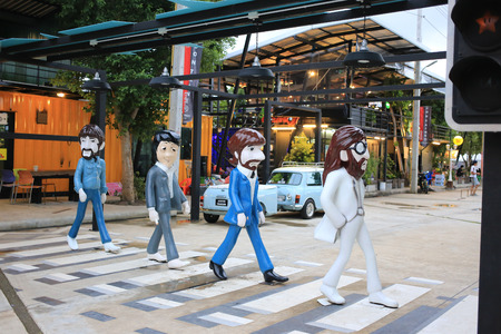 Trang, Thailand - September 5, 2016: The Beatles Abbey Road zebra crossing fiberglass statue at Cinta Garden. The container style walking street market. The Beatles were an English rock band in 1960. Editorial
