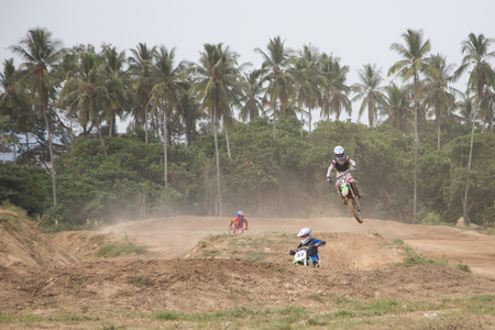 motorcross: Yala, Thailand - APRIL 20, 2014: Motorcross riders jump in Yala Motorcross Competition 2014. at Muangmai Track in Yala, Thailand Editorial