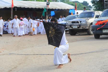 black flag: Trang, Thailand - October 7, 2016 : Spiritual  Medium with black flag pray for Chinese God at Tai-Sia-Hood-Cho Trang Shrine during Vegetarian Festival in Thailand