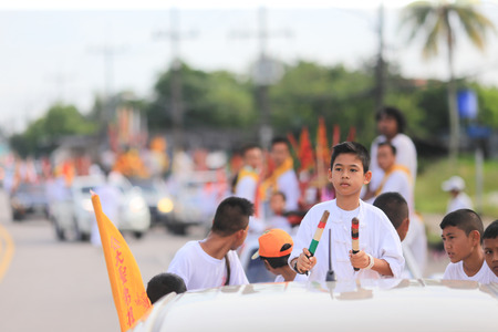 Trang, Thailand - October 7, 2016 : Young Male Drummer of Tai-Sia-Hood-Cho Trang Shrine on truck for The Street Procession during Vegetarian Festival in Thailand