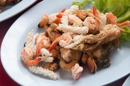 Shell Shrimp Fish and Octopus Seafood on dish with vegetable Stock Photo
