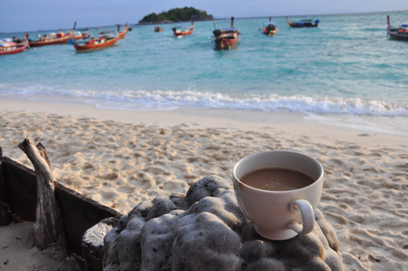 Cup of Coffee on the beach in the morning
