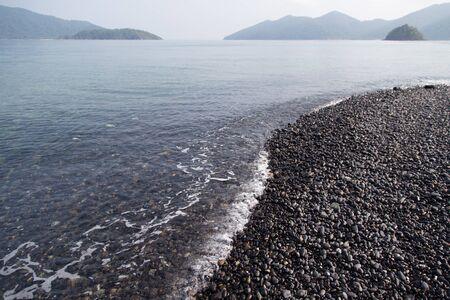 Hin-ngam Island beach has unique beautiful colorful stone Stock Photo
