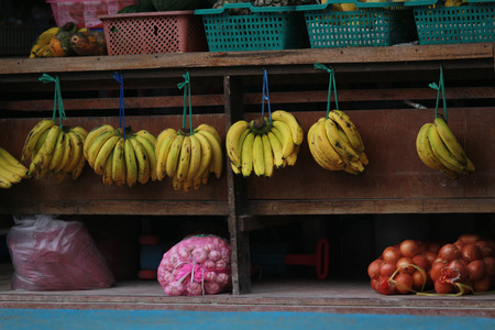 Banana hang in row for sell in market Stock Photo