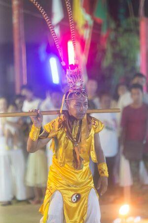 Trang, Thailand - October 14, 2018: Chinese God Monkey King spiritual medium at Tai-Sia-Hood-jow Trang shrine during vegetarian festival.