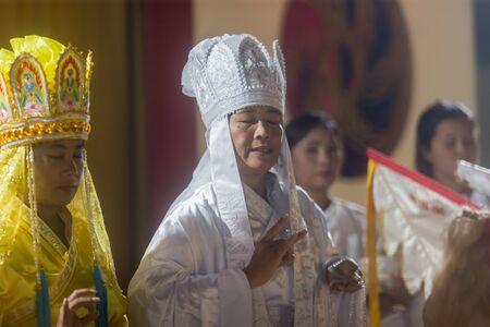Trang, Thailand - October 14, 2018: Chinese God spiritual medium (Guan Im deity) pray for god at Tai-Sia-Hood-jow Trang shrine during vegetarian festival. Editorial