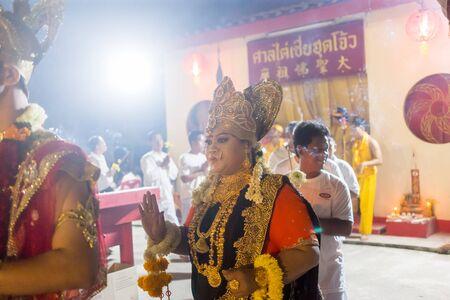 Trang, Thailand - October 14, 2018: Indian God spiritual medium pray for god at Tai-Sia-Hood-jow Trang shrine during vegetarian festival.